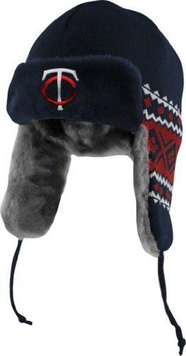 New Era Minnesota Twins Navy Blue-Red Team Trapper Beanie by New Era. $21.99. Officially licensed. Machine washable. Knit construction for maximum comfort. Quality graphics. You have endured some nasty weather to watch your Twins demolish the competition. You almost felt sorry for the foes for even entering the stadium - like innocent bunny rabbits walking into a trap. This season, don't even try to keep your head warm with any more lousy black beanies; dress for the occasion...