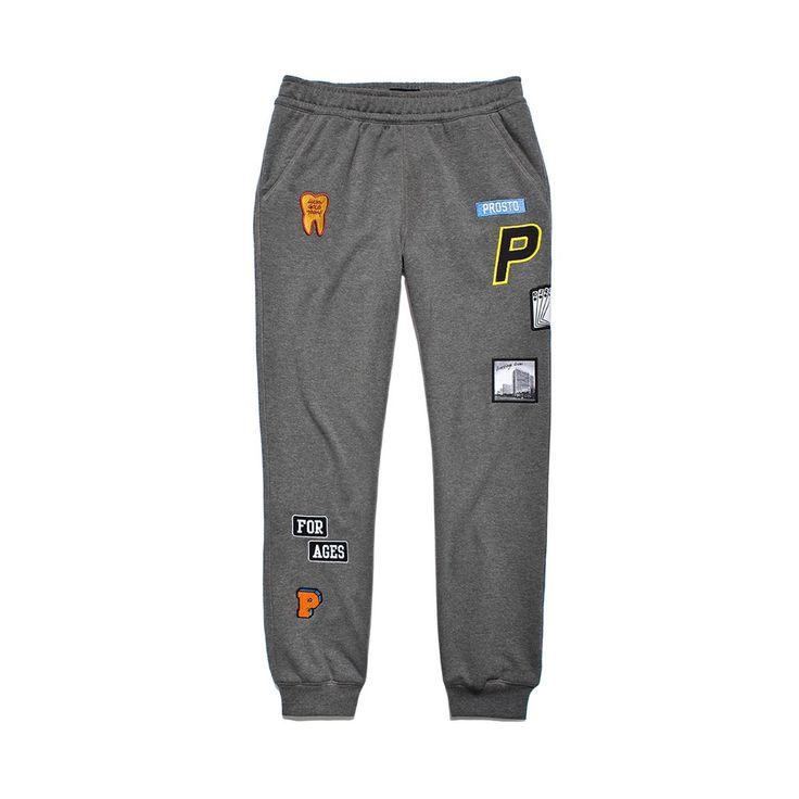 Spodnie Dresowe SCOUT MEDIUM HEATHER GREY Męskie baweniane spodnie dresowe. Na nogawkach rozmieszczone naszywki wykonane różnymi technikami.