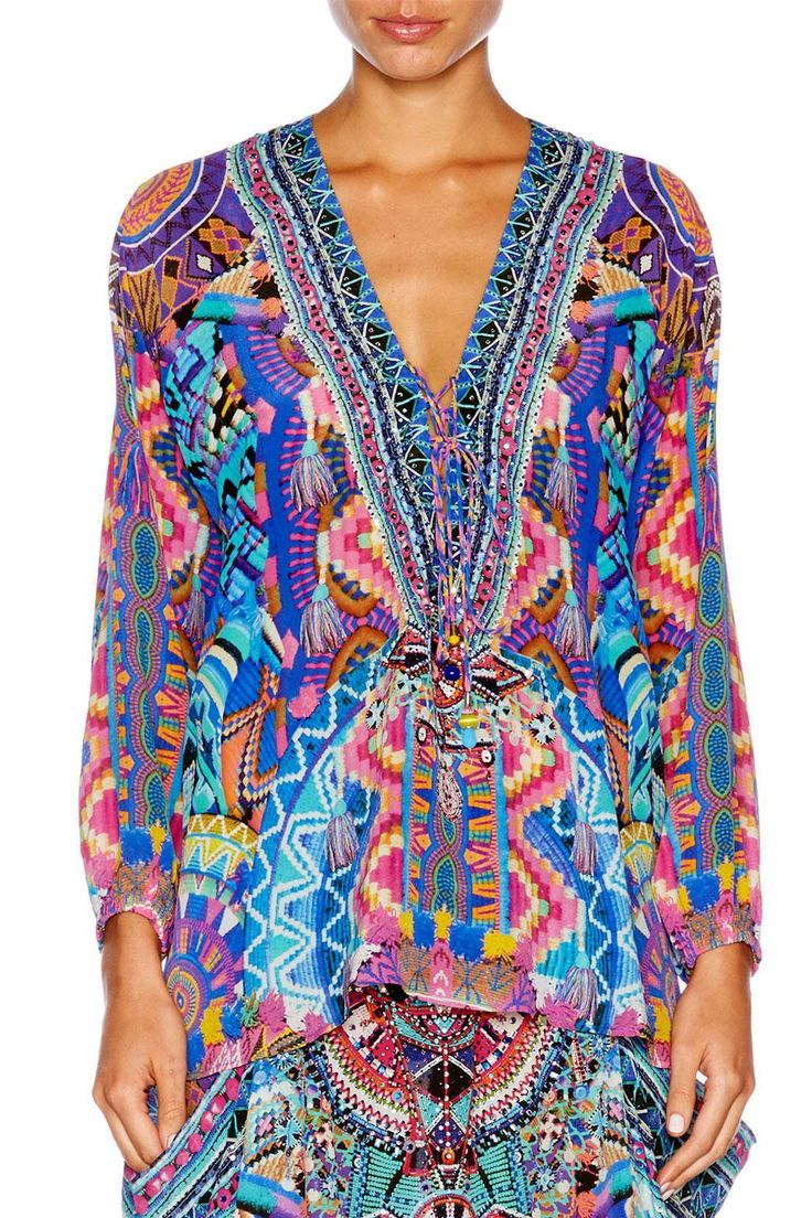 Blending Moroccan tribal patterns and embroidery, this Lace Up Shirt is crafted from a luxe silk crepe with crystal embellishments applied along the lace up neckline. In a billowing, relaxed fit, this is a true bohemian wardrobe essential.   Lace Up Shirt by Camilla. Clothing - Tops - Blouses & Shirts Melbourne, Victoria, Australia