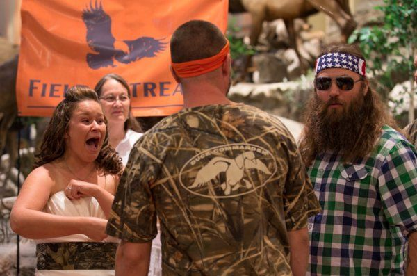 """Cast member Willie Robertson stopped by as super-fan couple Mehgan Cook and Charlie Miller tied the knot on Saturday, August 17, at a Field & Stream store in Pennsylvania. They also brought their own piece of """"Duck Dynasty"""" into their family when they named their 5-month old son Jase in honor of Willie's brother."""