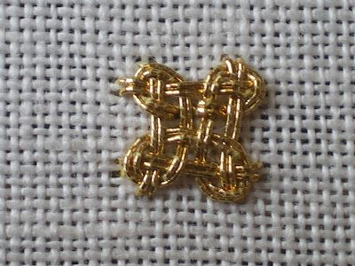 Various interlacing knots, in goldwork