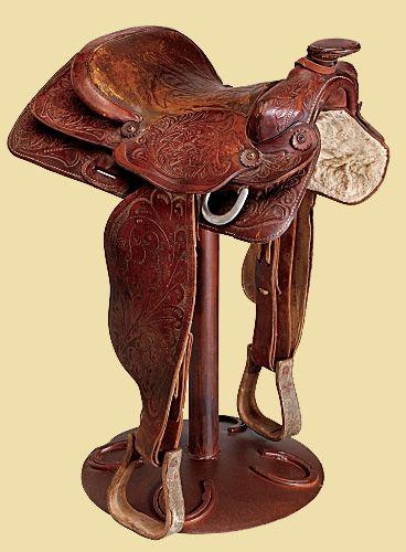 Saddle bar stools...just like Million Dollar Cowboy Bar in Jackson, WY!