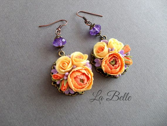 Earrings made of polymer clay with flowers roses