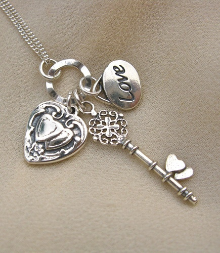 Heart and key charm pendants on a sterling silver necklace - the key to your heart . . and your love?