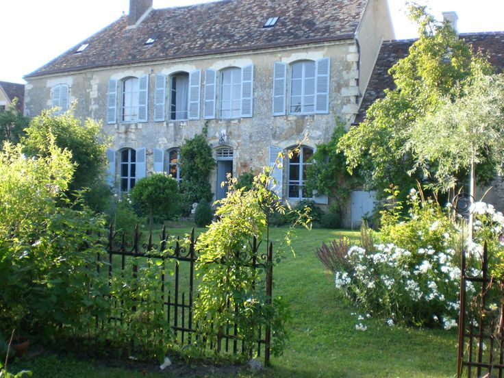 Beautiful French house with the most perfect colours; faded blue, grey walls and splashes of bright green.
