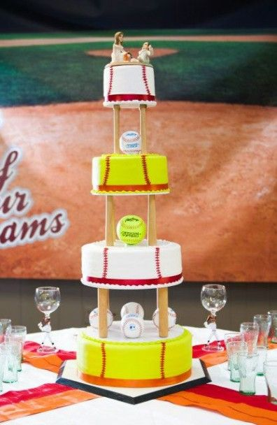 Field of Our Dream  We alternated our cake with baseball and softball to go along with the theme. Our topper was clay figurines that we order to look like us. Our classes were wine classes with baseball hitters as the stem of the glass. We used mini coca-cola classes for the wedding party to stay with the theme. We also used red and orange Gatorade to toast with so we could stay with our colors.