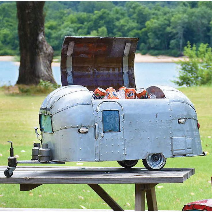 Vintage Camper Cooler  Built for duty, and perfectly suited for outdoor entertaining, our vintage coolers deliver free-wheeling fun. Each cooler is handcrafted from recycled 44-gallon oil drums.  #vacation #sale #freeshipping #promocode #couponcode #mensgifts #uniquegifts #mancave #memorabilia #sculptures #sportsmemorabilia #moviememorabilia #mensaccessories #novelty #cooler #vintage #camper #rv