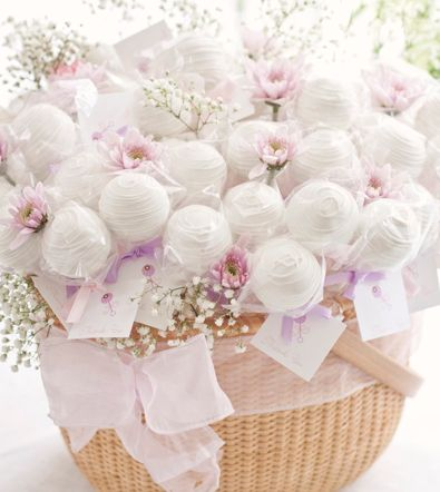 individually wrapped cake pops arranged in a basket with fresh flowers ~ cute presentation idea for showers, woman's birthday, Easter, etc. | by Cape Cod Lollicakes in Massachusetts (now closed) | photo by Lauren Tomasella Photography