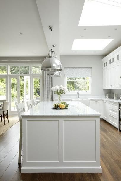 White kitchen with skylights