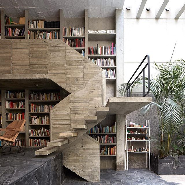 The Mexico City home and studio of Mexican sculptor @_pedro_reyes_ and his fashion designer wife @carlafernandezmx features crazy paving floors, as well as a staircase and double-height library rendered in coarse concrete. Find out more on dezeen.com/architecture #architecture #house #Mexico #concrete Photograph by @edmundsumner.