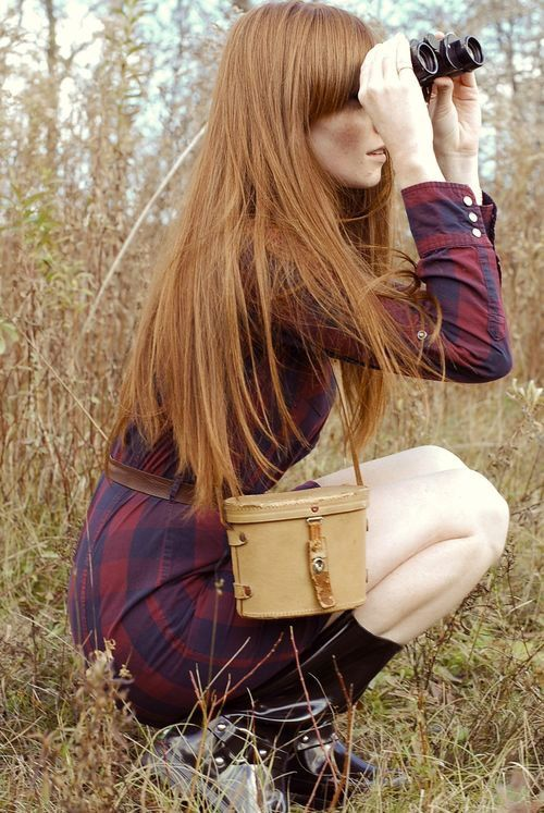 strawberry blonde, length with blunt bangs, plus a miniature train case purse, plaid shirt dress, brown leather belt and binoculars