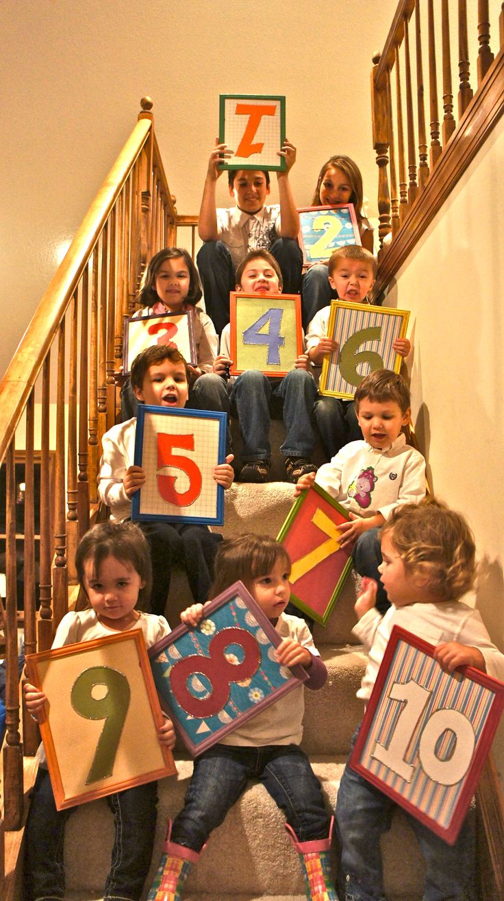 For grandparents... darling picture of all the grandkids holding their # in birth order! I wonder if we could fit all 45 Eliason grandkids in a photo like this...