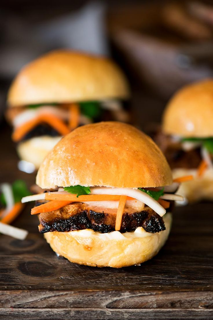Juicy spicy, savory, sweet marinated pork beautifully charred, topped with sweet & sour pickled daikon & carrots between two heavenly soft, fluffy rolls.