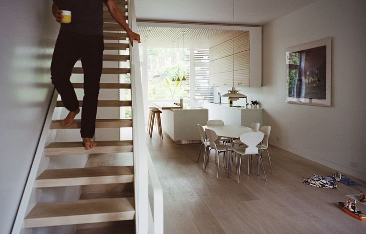 In undertaking a gut renovation of a town house in Brooklyn's Park Slope neighborhood, husband and wife Jesper Meyer and Rimjhim Dey drew upon design elements from their respective roots in Denmark and India to create a home that's wholly serene and accented with subtle pops of bright color. American white-oak planks, finished with lye and pigmented with whitening oil from Danish company Junckers, line the staircase and floors throughout; the dining area is furnished with Ant chairs by Arne…