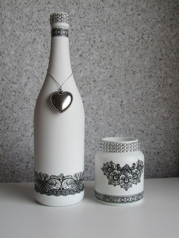 Gesso en rub-on stickers. An ordinary wine bottle and a glass jar to start from? Nice outcome.  http://media-cache-ak0.pinimg.com/originals/b8/c5/2c/b8c52cd7837b53c0f1e398f87570a91d.jpg.