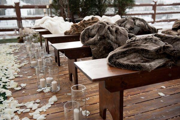 Wintry Ceremony Seating    Photography: Handeland Tesoro Photography   Read More:  http://www.insideweddings.com/weddings/snowy-outdoor-winter-ceremony-cozy-lodge-reception/522/