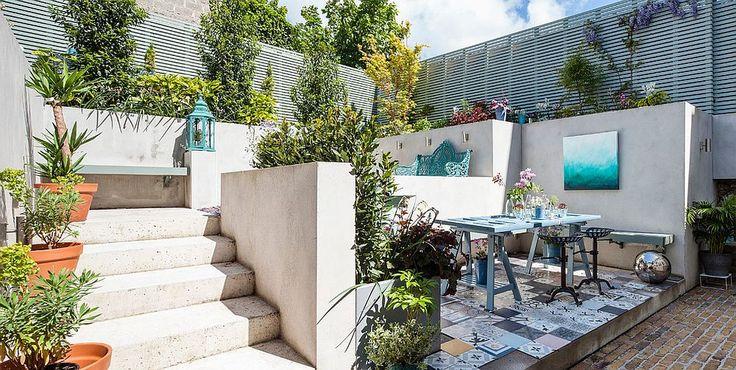 Terrazzo eclettico con sapore mediterraneo grazie al pavimento patchwork - idea disegno