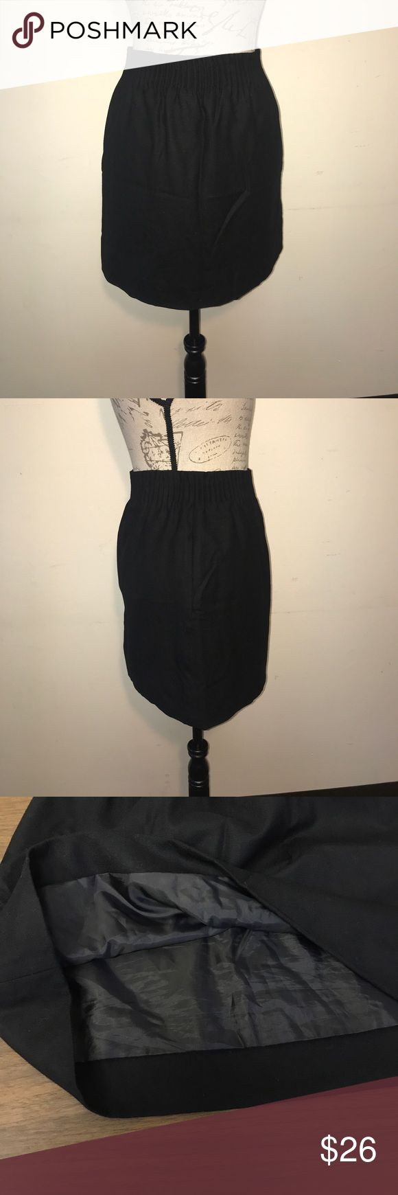 "J. Crew Wool Mini Skirt J. Crew size 0 black wool mini skirt. Top 2.25"" of Skirt has elastic waist & it's puckered. On seam-side pockets. Fully lined. Laid flat waist: 13"", hips: 20"", length:17"". Shell: 97% Wool 3% Elastane. Lining: 100% Polyester. Like new! Retail: $89.50 J. Crew Skirts Mini"