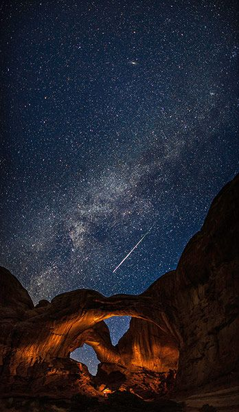 A meteor streaks across the sky above Arches National Park in Utah during the annual Perseid meteor shower. Photograph: Thomas O'Brien