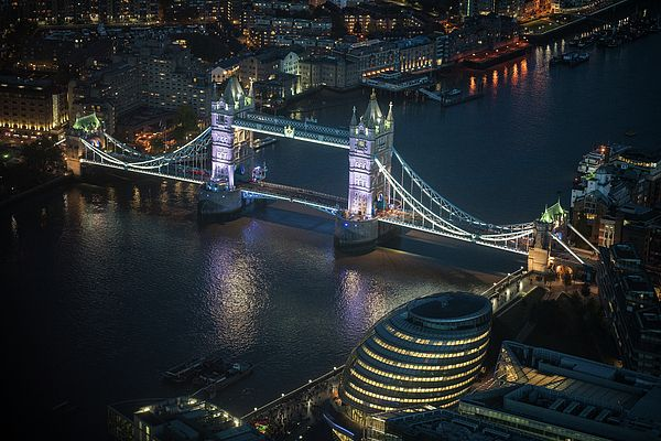 Tower Bridge and the Thames in London at night from the Shard.  Photography by Mike Reid