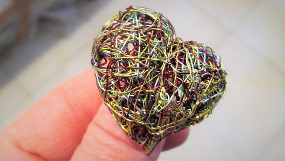 Heart ring, green ring, adjustable ring, large ring, silver ring, wire sculptural ring, anniversary gift for women, hippie Christmas gift  Handmade wire sculpture, heart green ring, made of colored copper wire and silver. The overall size of the adjustable, large, statement, heart, hippie Christmas jewelry, is 3.2 cm. (1,3 in). The base of the ring is solid silver, adjustable for all finger sizes. A unique anniversary gift for women!