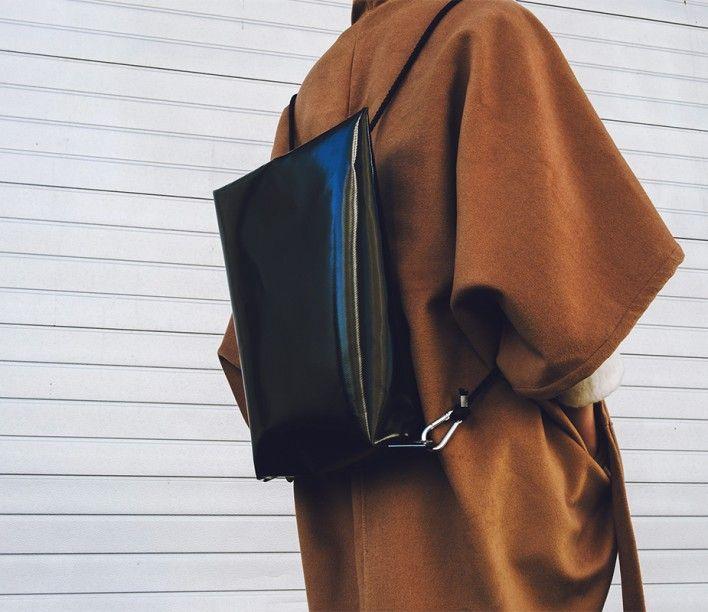 Minal Flat Top Backpack by Black PVC/ DI U DI