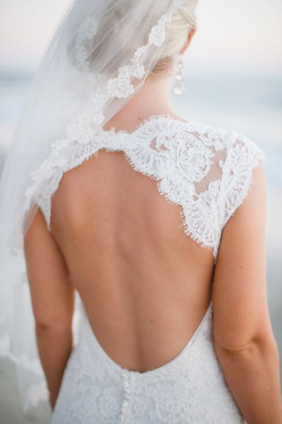 Lace peekaboo backless wedding dress: http://www.stylemepretty.com/collection/2115/ Photography: Hazelnut - http://hazelnutphotography.com/
