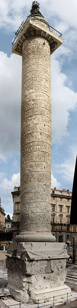 Trajan's column, is a Roman triumphal column that commemorates Roman emperor Trajan's victory in the Dacian Wars. It is considered to be the masterpiece of Roman sculptural art.  It was dedicated to Trajan by Hadrian.  (isn't it gorgeous?  I could live in Rome)
