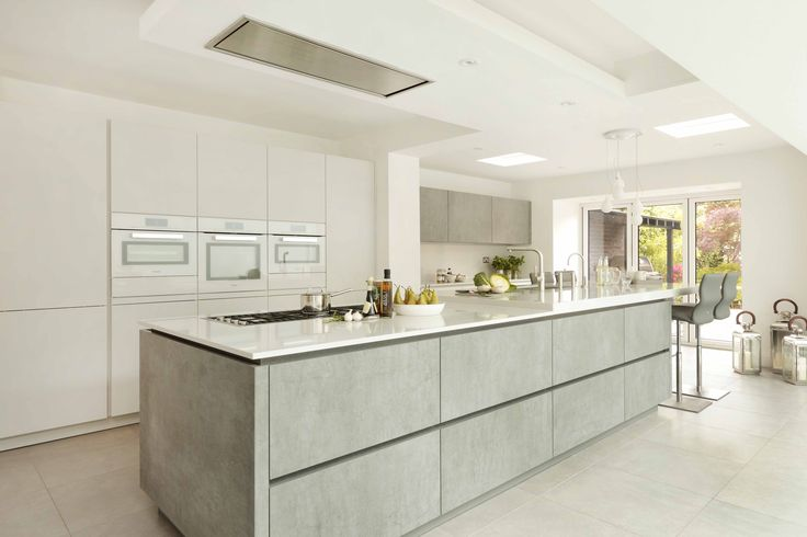 This stylish and family friendly kitchen was created by Graham Robinson of Halcyon Interiors, The ALNO Store and features Miele appliances. The large island is split into two zones – cooking and preparation closest to the ovens, with seating and socialising nearest the garden. Careful thought has gone into selecting the appliances in this kitchen so as not to interfere with family life - the Miele dishwasher under the breakfast bar was chosen for its lack of noise #kitcheninspiration