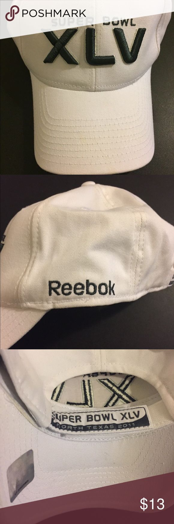 Reebok Super Bowl XLV 2011 Texas Cap Hat Reebok Super Bowl XLV  Green Bay Packers vs Pittsburgh Steelers  Unisex Size: One size fits all Style: Velcro strap Color: White and Silver Brand: Reebok Condition: Pre Owned  Any questions, please ask!  JG. MINISTRIES Reebok Accessories Hats