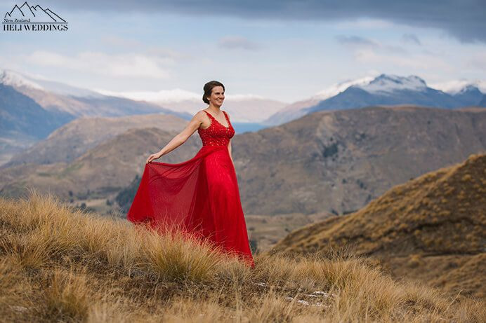 Mountain wedding by 4wd in Queenstown with a bride in red wedding dress