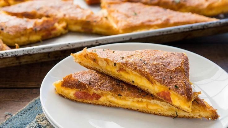 What could be better than combining the two ultimate comfort foods: grilled cheese and pizza? This tasty mash-up will have everyone asking for more!
