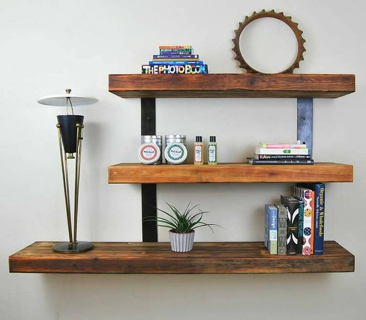 You can create this wooden pallet shelf in which we have used metal pieces to make it more useful. It contains three sections on which you can put various items like books, small plants, decoration pieces etc. We have used a big wooden pallet to make the lower shelf section.