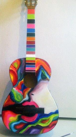 """""""La música con alegría"""" (guitarra de madera) - técnica: óleo"""