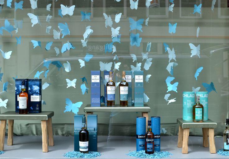shop window butterfly 39 s and liquor made by caroline dijkman blik window display. Black Bedroom Furniture Sets. Home Design Ideas
