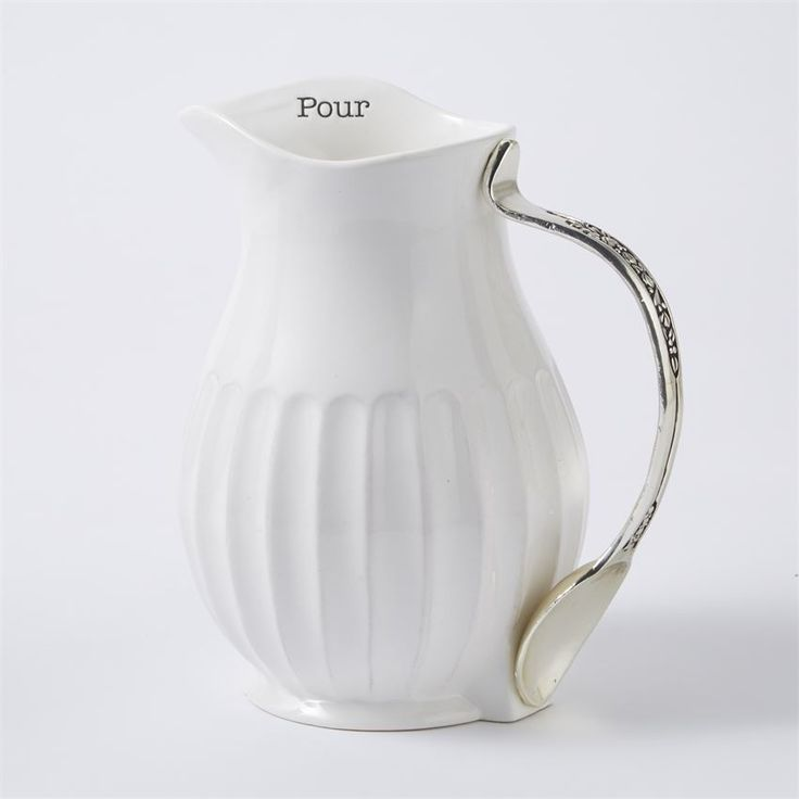 "Ceramic pitcher features fluted texture, silverplate spoon handle and ""Pour"" stamped on inside rim."