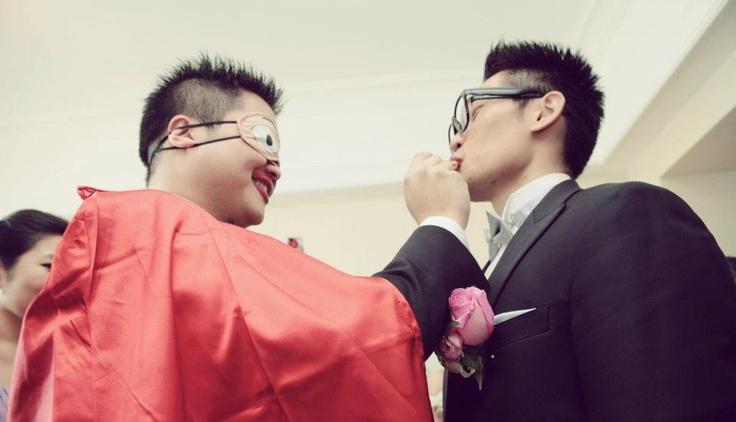 putting lipstick on the groomsmen blindfolded