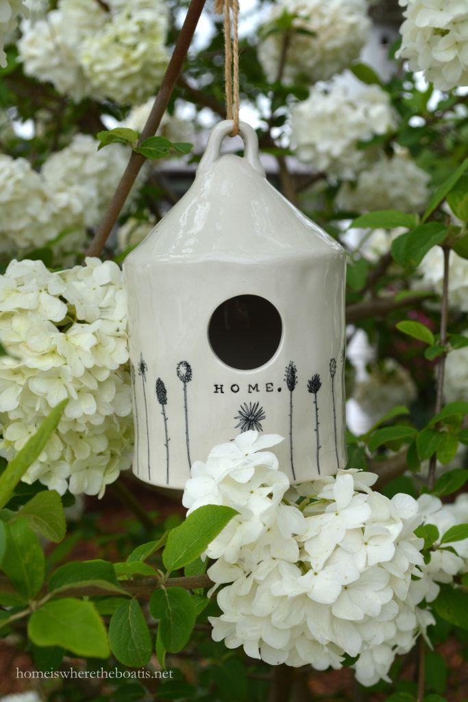 Ceramic bird house and snowball viburnum | homeiswheretheboatis.net #spring #garden #bird