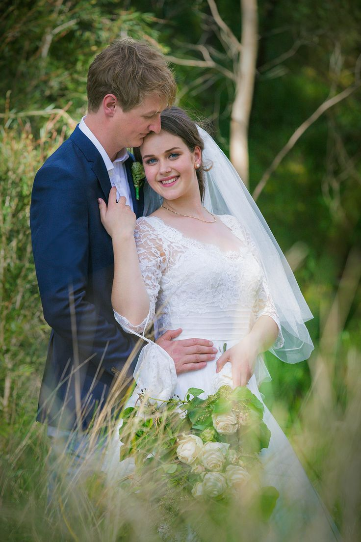 We posed the bride and groom off the beaten path in some native grasses
