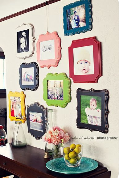 Here's a neat way to hang pictures. To get this look, buy wood plaques, paint, then use Modge Podge to glue on the pictures.