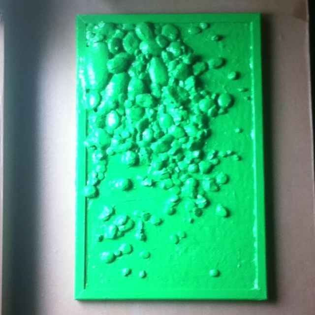 'stones from crete'  32cm X 42cm   pinboard, various stones from the greek island: crete, ultra bright green and 4 layers of mega shinny laquerd paint for the finishing