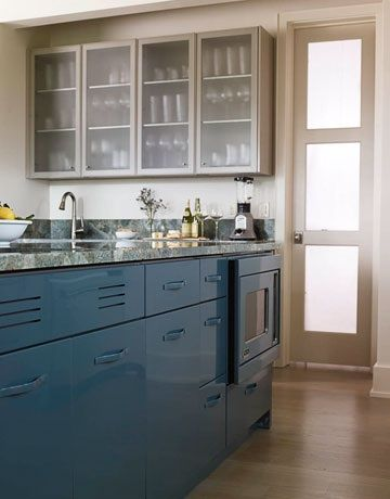 "Peacock Blue Kitchen Cabinets: ""The cabinets in this kitchen are made of powder-coated stainless steel, so they're not only pretty, they're pretty permanent. The company that made the cabinets, St. Charles, is now owned by Viking, which means you can order appliances in the same color."""