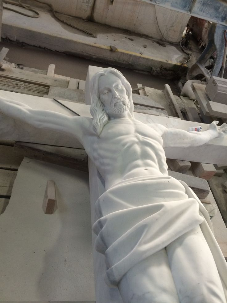 The crucifix, carved out of marble, has been shipped in from the Philippines for St. Pius X Church in Scarsdale, NY. It arrived chipped and broken, but Petrillo Stone Corporation is working to make it good as new.