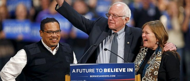 U.S. Democratic presidential candidate Bernie Sanders (C) stands on stage with his wife, Jane O'Meara Sanders (R), and U.S. Rep. Keith Ellison (DFL-MN) before speaking to supporters during a campaign rally in St. Paul, Minnesota, January 26, 2016. REUTERS/Eric Miller