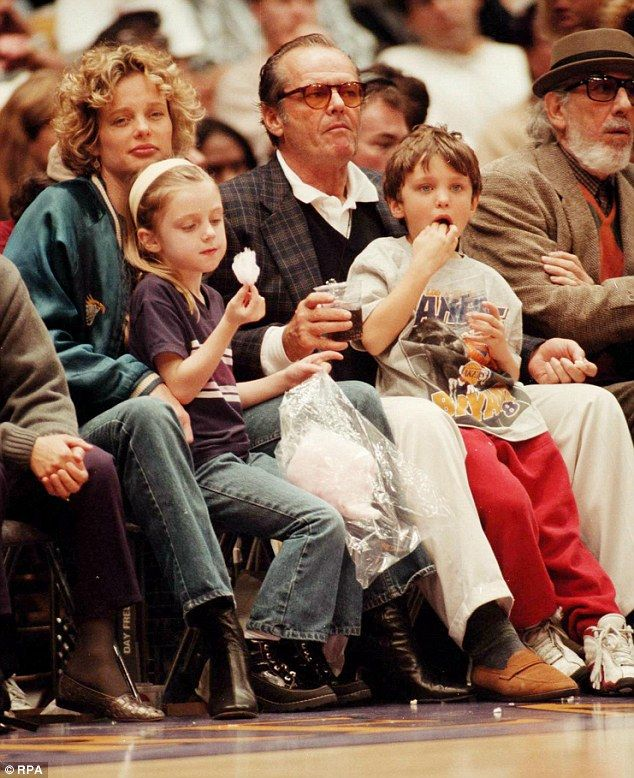 His folks: Ray with mom Rebecca Broussard, dad Jack and sister Lorraine at a Lakers basketball game in Los Angeles in 1998