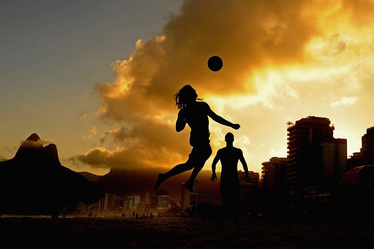 A man plays football on Ipanema beach ahead of the FIFA Confederations Cup Brazil 2013 on June 5, 2013 in Rio de Janeiro, Brazil.