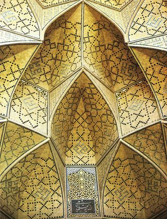 Detail from the Seljuk Friday mosque at Isfahan.  The architectural complexity of the muqarnas is highlighted  by the geometric pattern of the decoration.