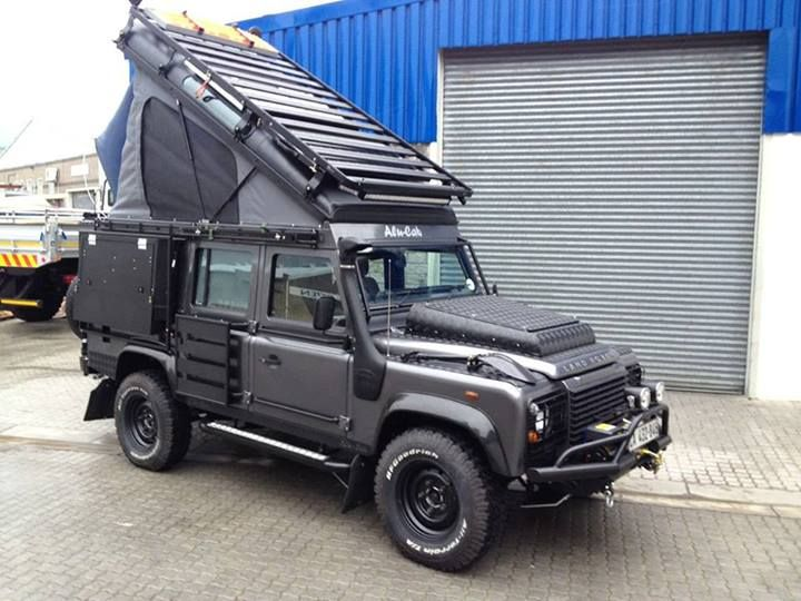 #LandRover : lifting roof causes other things to be mounted elsewhere. BTW - the black shovel looks good on the wing. I also wonder what under the hood.