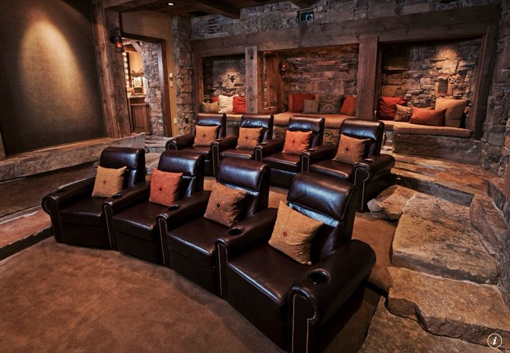 Rustic Home Theater with Exposed beam, Columns, Carpet, Home theater seating, can lights, Standard height