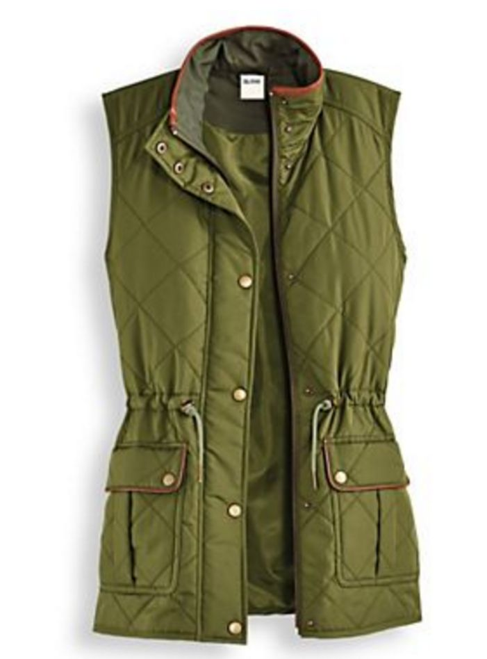 % Polyester. Made in USA. Diamond - quilted vest featuring two real front pockets. Warm water wash delicate cycle. Tumble dry delicate cycle. Comes in Green.
